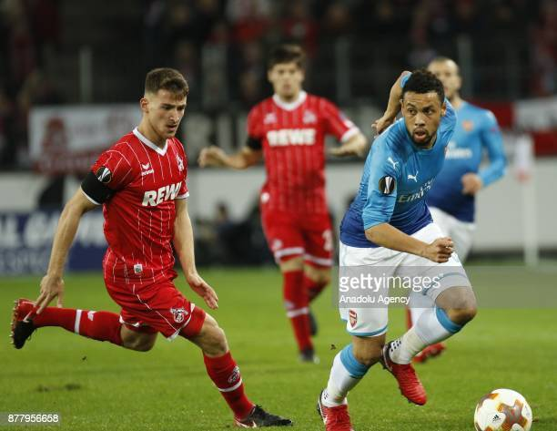 Salih Ozcan of 1FC Cologne competes with Francis Coquelin of Arsenal FC during the UEFA Europa League Group H soccer match between 1FC Cologne and...
