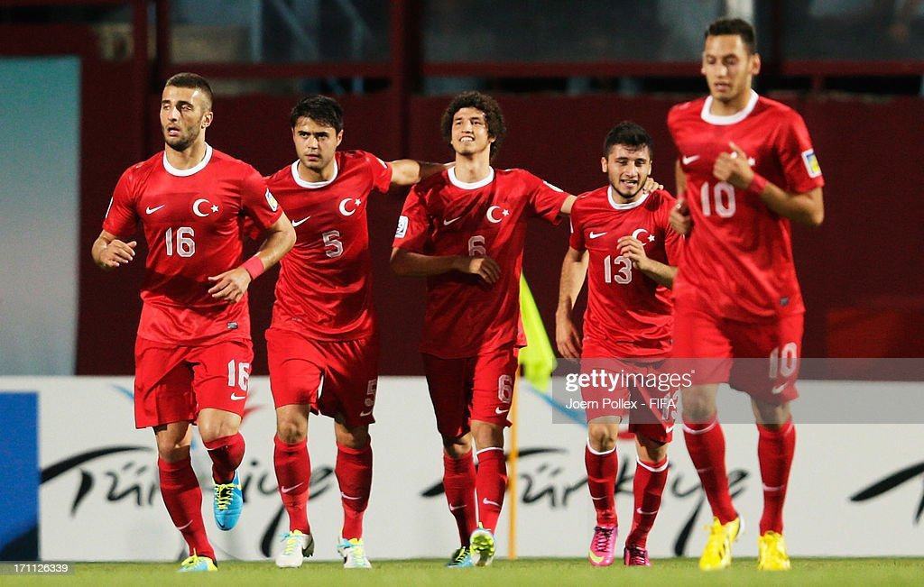 Salih Ucan (C) of Turkey celebrates with his team mates after scoring his team's first goal during the FIFA U-20 World Cup Group C match between Turkey and El Salvador at Huseyin Avni Aker Stadium on June 22, 2013 in Trabzon, Turkey.