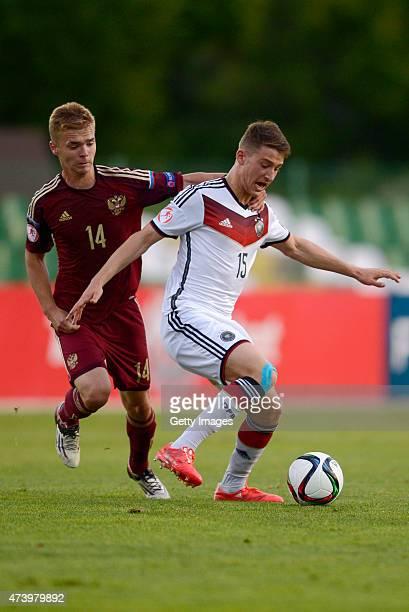 Salih Özcan of Germany U17 challenges Artem Selyukov of Russia U17 during the UEFA European Under17 Championship Semi Final match between Germany U17...