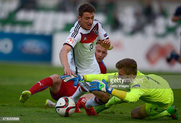 Salih Özcan of Germany U17 is fauled by Daniel Köstl of Czech Republic U17 in the penalty during the UEFA European Under17 Championship match between...