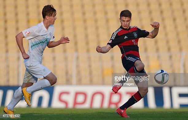 Salih Özcan of Germany U17 passes the ball in front of Vitja Valencic of Slovenia U17 during their UEFA European Under17 Championship Final...
