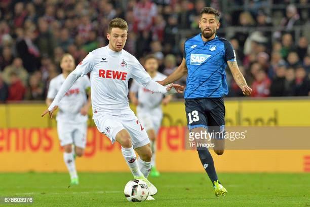 Salih Özcan of Koeln and Kerem Demirbay of Hoffenheim battle for the ball during the Bundesliga match between 1 FC Koeln and TSG 1899 Hoffenheim at...