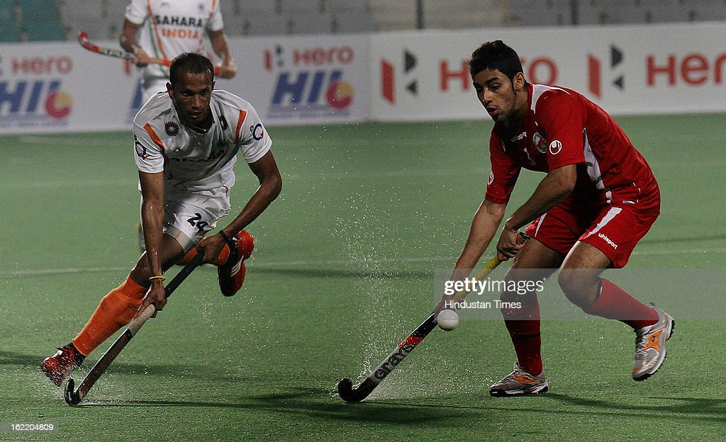 Salim Al Zadjali Ali of Oman takes the ball away from India's Sunil Sowmarpet during Hockey World League round 2 at Major Dhyan Chand stadium on February 20, 2013 in New Delhi, India. Indians mauled Oman side by 9-1.