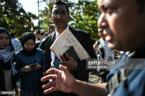 Salim Bashir one of the lawyers of Vietnamese Doan Thi Huong holds documents as he walks after a pretrial procedure for the assassination of Kim...