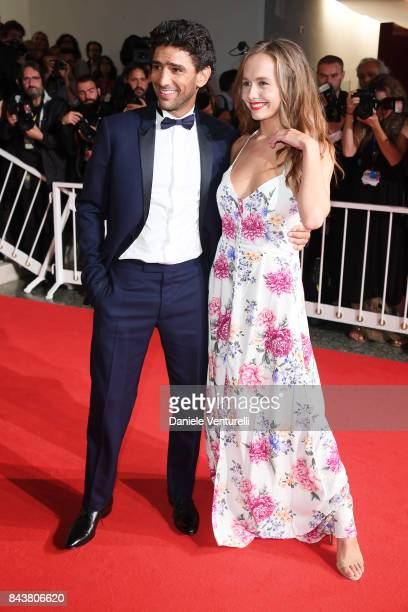 Salim Kechiouche and Lou Luttiau walk the red carpet ahead of the 'Mektoub My Love Canto Uno' screening during the 74th Venice Film Festival at Sala...