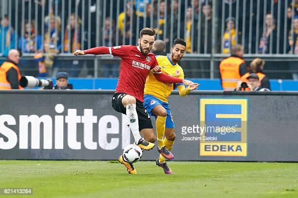 Salim Khelifi of Braunschweig challenges Kenan Karaman of Hannover during the Second Bundesliga match between Eintracht Braunschweig and Hannover 96...