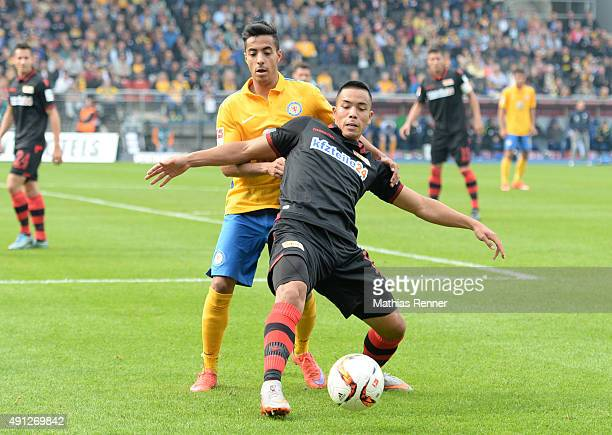 Salim Khelifi of Eintracht Braunschweig and Bobby Wood of 1 FC Union Berlin during the Second Bundesliga match between Eintracht Braunschweig and 1...