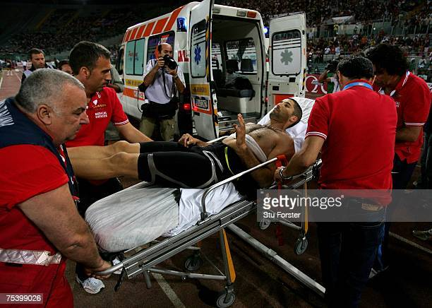 Salim Sdiri of France is stretchered off after being injured by a wayward javelin that struck him as he competed in the Mens Long Jump during the...