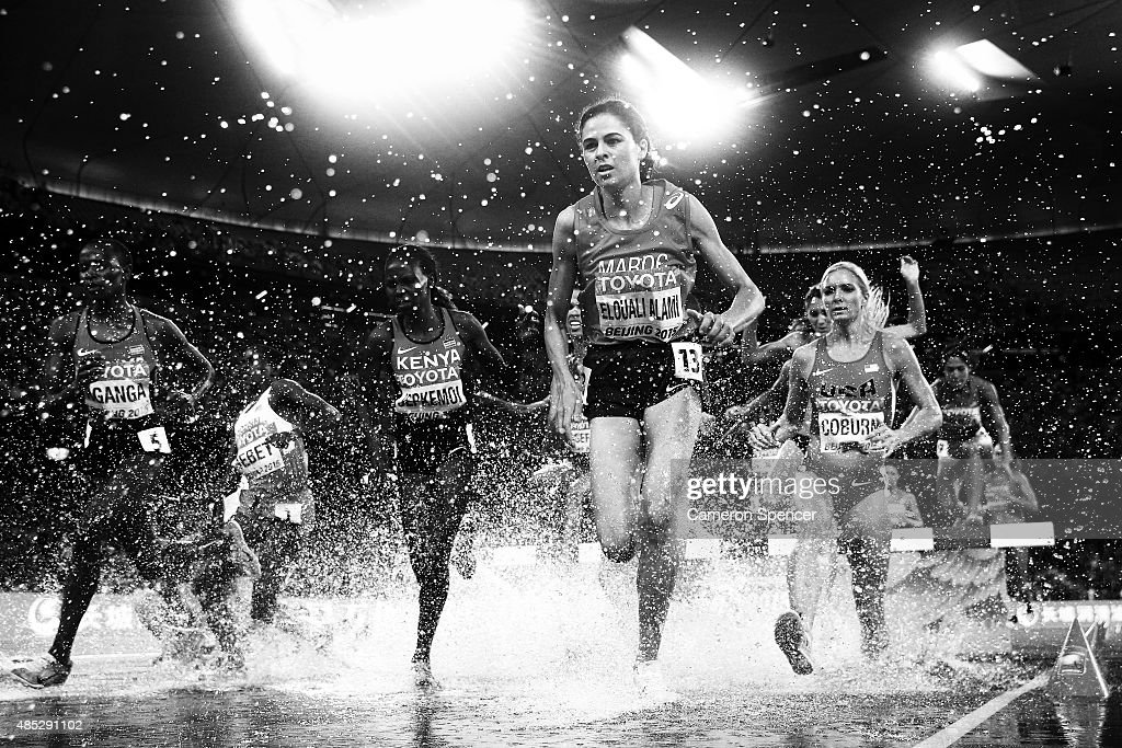 Salima El Ouali Alami of Morocco leads competitors out of the water jump in the Women's 3000 metres steeplechase final during day five of the 15th IAAF World Athletics Championships Beijing 2015 at Beijing National Stadium on August 26, 2015 in Beijing, China.