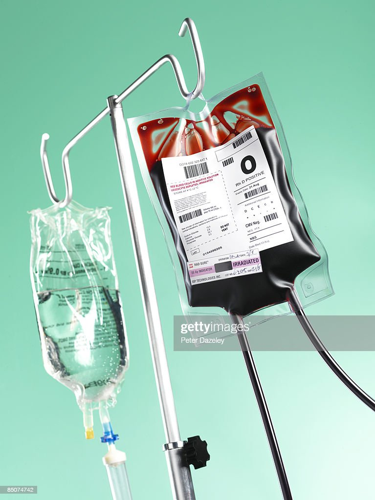 Saline drip and blood bag in operating theatre. : Stock Photo