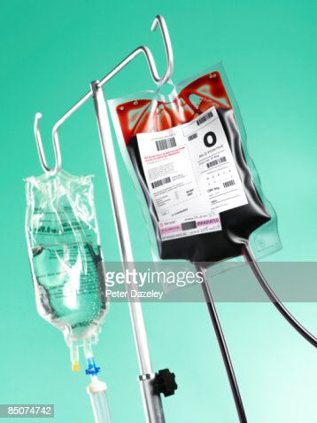 Saline drip and blood bag in operating theatre.