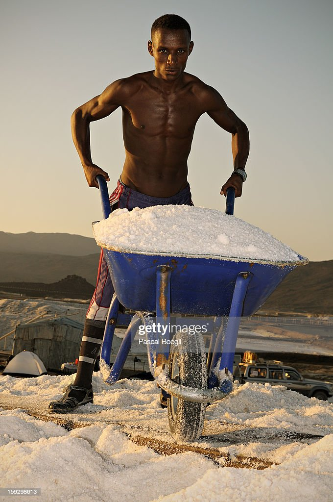 CONTENT] Salines of Afdera (Afrera) where workers start very early to avoid the terrific heat. The salt that comes from Afdera covers 65% of the country salt consumption; the remaining 35% is imported. Danakil depression, Ethiopia