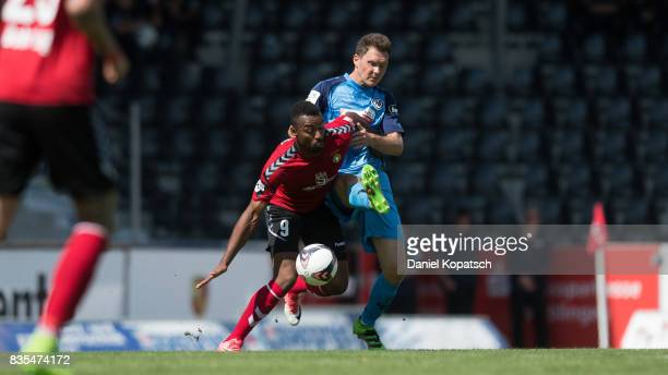 Saliou Sane of Grossaspach is challenged by Robert Mueller of Aalen during the 3 Liga match between SG Sonnenhof Grossaspach and VfR Aalen at on...