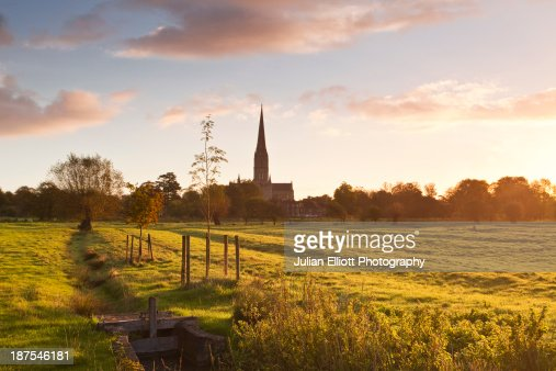 Salisbury cathedral and the water meadows at dawn.