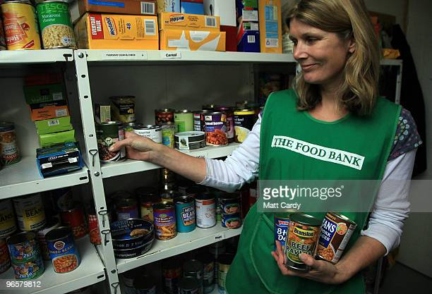 Salisbury foodbank volunteer Jill Plant sorts a donation of food at the foodbank centre and cafe on February 11 2010 in Salisbury England The charity...