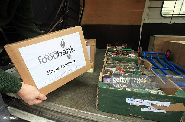 Salisbury foodbank volunteer Richard Parsons takes a donation of food from the foodbank's van to deliver to a client on February 11 2010 in Salisbury...