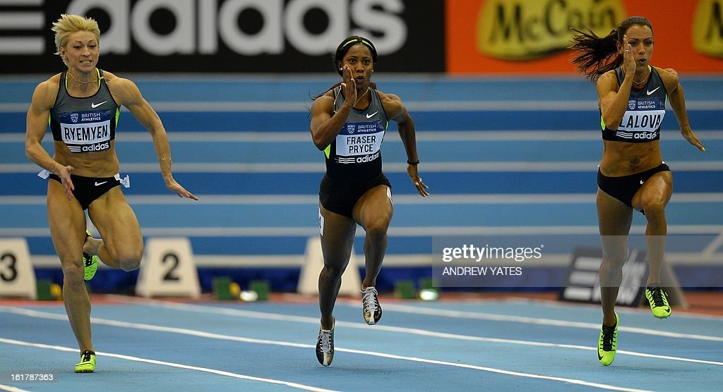 Sally Ann Fraser Pryce of Jamaica (C) runs against Ivet Lalova of Bulgaria (R) and Mariya Ryemyen of Ukraine during the womens 60 metres semi final during the British Athletics Grand Prix at the National Indoor Arena in Birmingham, central England on February 16, 2013. AFP PHOTO/ANDREW YATES.