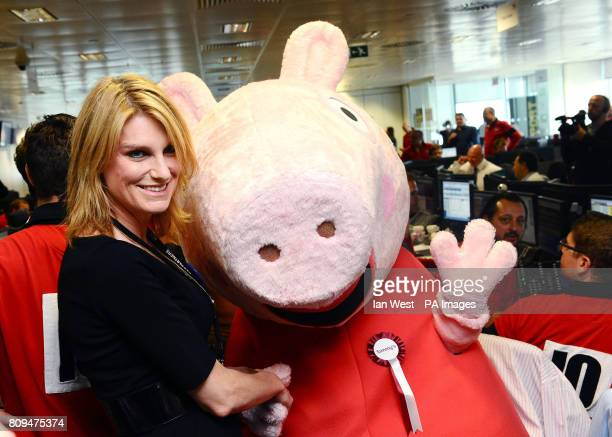 Sally Bercow poses with Peppa Pig as she helps out on the trading floor during the BGC Partner's 7th Annual Charity Trading Day at Churchill Place in...
