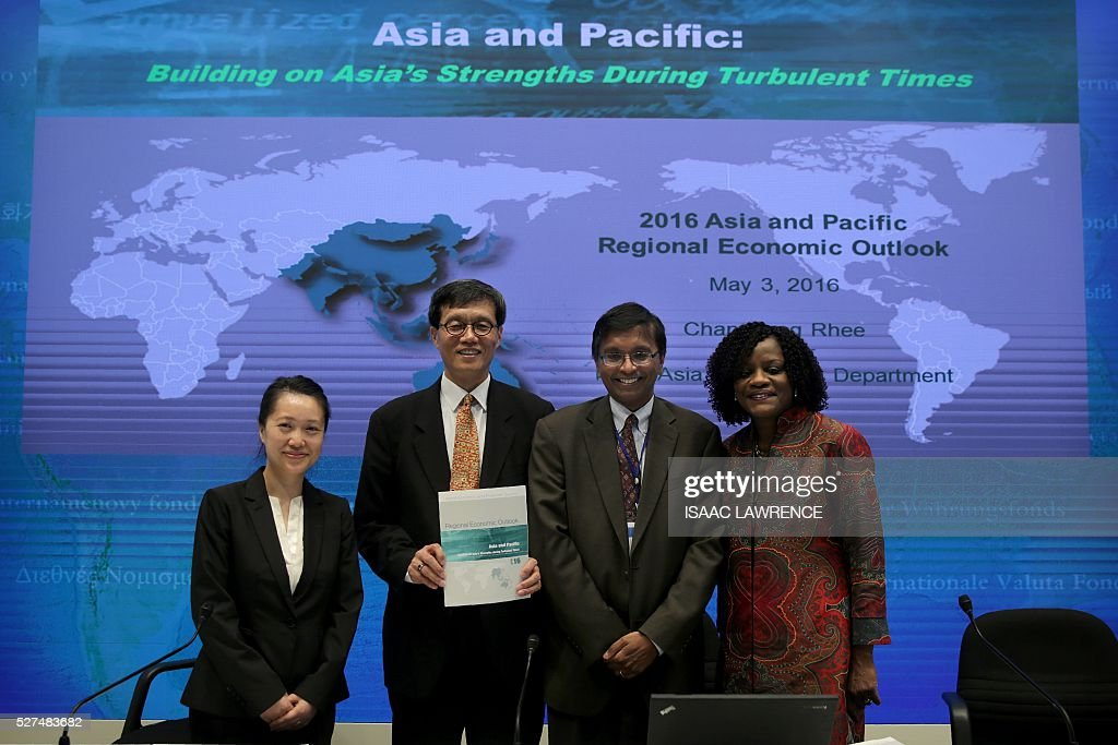 Sally Chen, resident representative in Hong Kong, Changyong Rhee, director of the Asia and Pacific Department, Ranil Salgado, division chief for Asia and Pacific and Rhoda Weeks-Brown, deputy director of the Communications Department for the International Monetary Fund (IMF), pose for a photo before at a press conference in Hong Kong on the IMF's regional economic outlook for Asia and Pacific on May 3, 2016. China and Japan's economies are expected to slow sharply over the next two years but Asian growth will remain strong as domestic demand takes up the slack from weak global trade, the IMF said on May 3. LAWRENCE