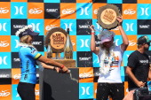 Sally Fitzgibbons of Australia and Lakey Peterson of USA hold their trophies for first and second place at the Nike US Open of Surfing on August 7...