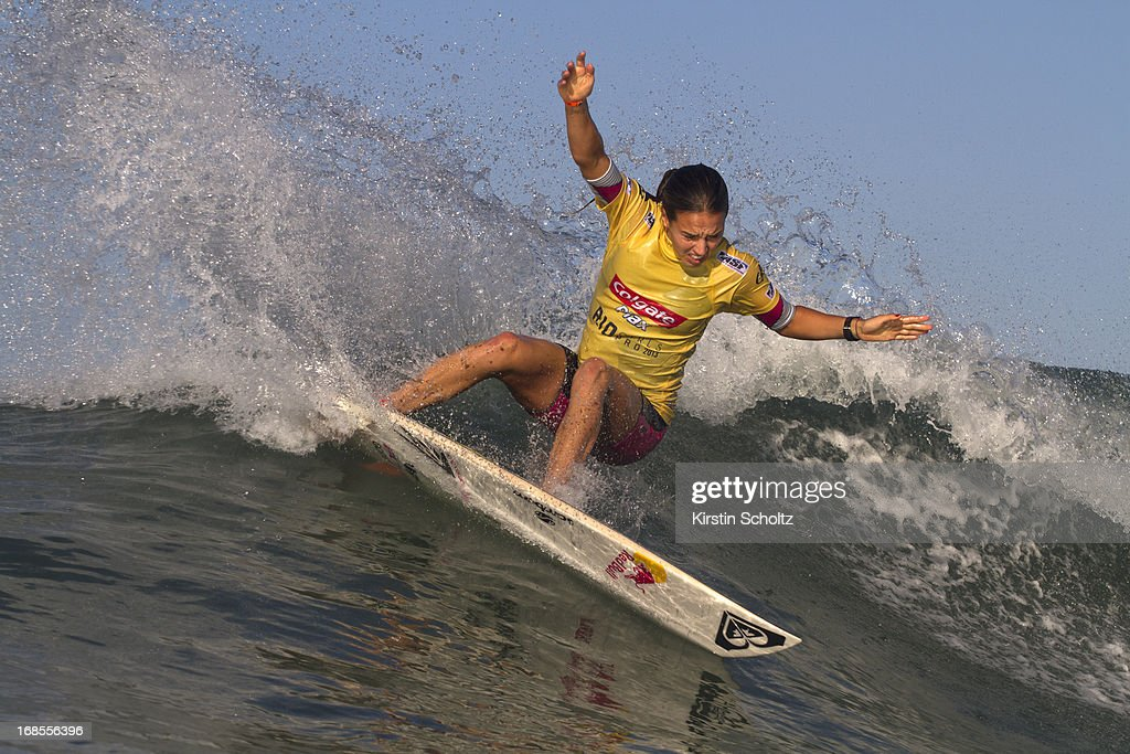 <a gi-track='captionPersonalityLinkClicked' href=/galleries/search?phrase=Sally+Fitzgibbons&family=editorial&specificpeople=4113410 ng-click='$event.stopPropagation()'>Sally Fitzgibbons</a> of Australia surfs to a runner up finish at the Colgate Plax Girls Pro on May 11, 2013 in Rio de Janeiro, Brazil.
