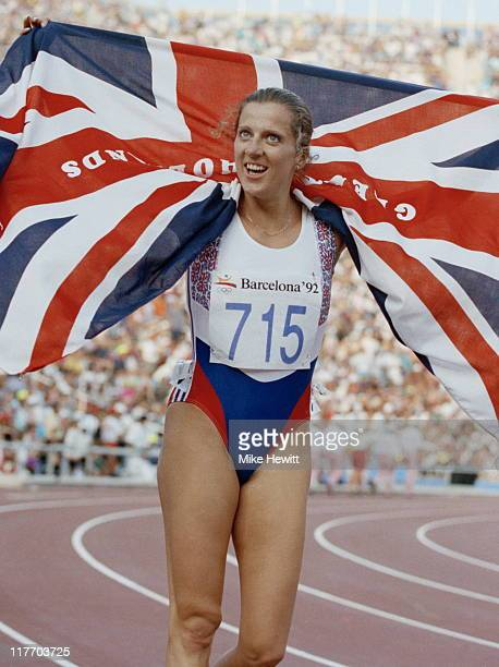 Sally Gunnell of Great Britain holds aloft the Union Jack flag as she celebrates winning the Women's 400 metres Hurdlesevent at the XXV Summer...