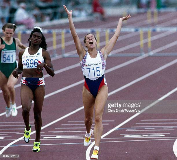 Sally Gunnell of Great Britain wins the women's 400 metres hurdles with Sandra FarmerPatrick of the United States second during the Summer Olympic...
