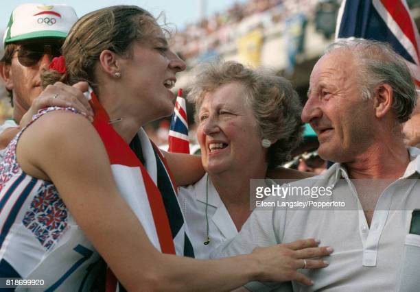 Sally Gunnell of Great Britain with her mother and father after winning the 400 metres hurdles event during the Summer Olympic Games in Barcelona on...