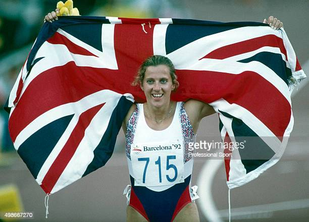 Sally Gunnell of Great Britain with the Union Jack after winning the women's 400 metres hurdles event during the Summer Olympic Games in Barcelona...