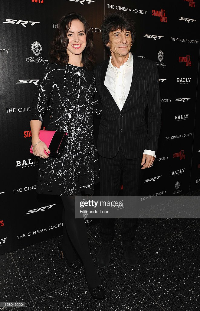 Sally Humphreys and musician Ronnie Wood (R) attends the premiere of 'Stand Up Guys' hosted by The Cinema Society with Chrysler and Bally at MOMA on December 9, 2012 in New York City.