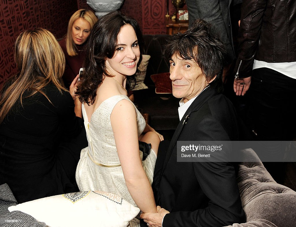 Sally Humphreys (L) and Ronnie Wood attend the Esquire and Tommy Hilfiger party celebrating London Collections: MEN AW13, hosted by Esquire editor Alex Bilmes and Tommy Hilfiger, at the Zetter Townhouse on January 7, 2013 in London, England.