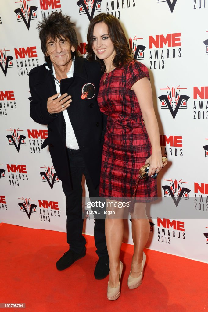 Sally Humphreys and Ronnie Wood attend the NME Awards 2013 at The Troxy on February 27, 2013 in London, England.
