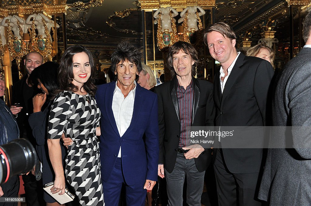 Sally Humphreys, Ronnie Wood, <a gi-track='captionPersonalityLinkClicked' href=/galleries/search?phrase=Mick+Jagger&family=editorial&specificpeople=201786 ng-click='$event.stopPropagation()'>Mick Jagger</a> and <a gi-track='captionPersonalityLinkClicked' href=/galleries/search?phrase=Tom+Hooper&family=editorial&specificpeople=681836 ng-click='$event.stopPropagation()'>Tom Hooper</a> attend the L'Wren Scott cocktail party during London Fashion Week Fall/Winter 2013/14 at on February 17, 2013 in London, England.
