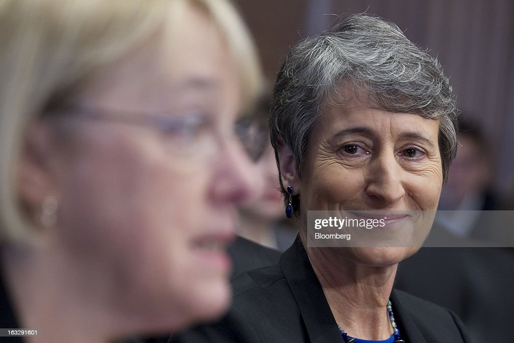 Sally Jewell, president and chief executive officer of Recreational Equipment Inc. (REI) and nominee for U.S. Interior secretary, right, looks on as Senator <a gi-track='captionPersonalityLinkClicked' href=/galleries/search?phrase=Patty+Murray&family=editorial&specificpeople=532963 ng-click='$event.stopPropagation()'>Patty Murray</a>, a Democrat from Washington, introduces her during a Senate Energy and Natural Resources Committee hearing in Washington, D.C., U.S., on Thursday, March 7, 2013. Jewell disclosed she owns shares in companies such as ConocoPhillips and Exxon Mobil Corp., which hold drilling leases managed by the Interior Department. Photographer: Andrew Harrer/Bloomberg via Getty Images