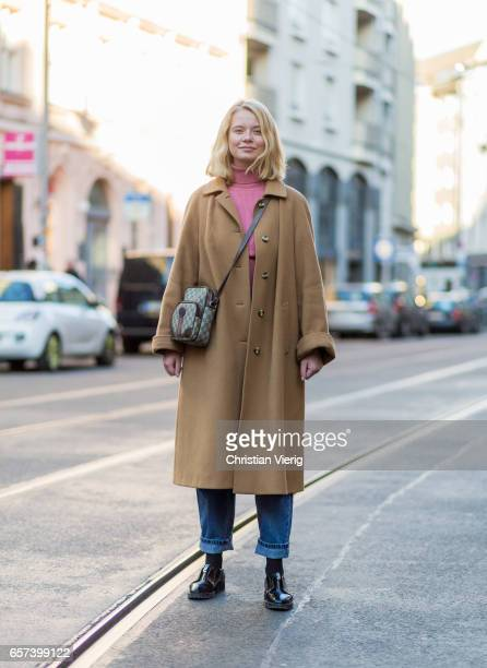 Sally Jo Ringhof wearing a Gucci bag denim jeans beige wool coat pink turtleneck on March 24 2017 in Berlin Germany