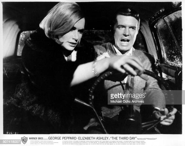 Sally Kellerman grabs the steering wheel as George Peppard tries to keep control in a scene from the Warner Bros movie 'The Third Day' circa 1965