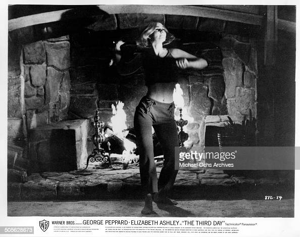 Sally Kellerman performs a sexy dance as she rendezvous with George Peppard in a scene from the Warner Bros movie 'The Third Day' circa 1965