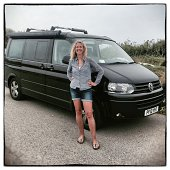 Sally Lawton from Croyde in Devon poses for a photograph besides her 2010 fifth generation T5 Volkswagen Transporter California in Newquay on August...