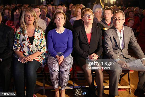 Sally Lindsay Justine Thornton Eddie Izzard and Ben Elton watch a video presentation before Labour leader Ed Miliband addressed supporters at a rally...