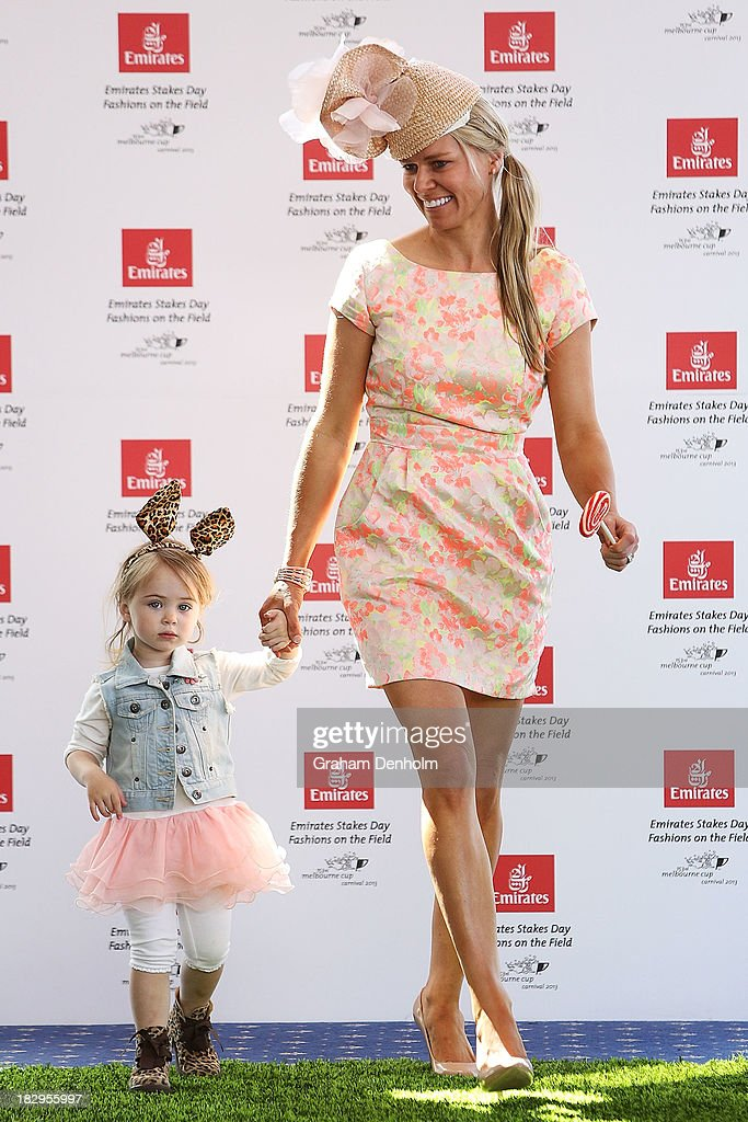Sally Marshall, wife of jockey Simon Marshall and their daughter Shugar Bella Marshall walk the runway at the Emirates Stakes Day Fashion on the Field Launch at Flemington Racecourse on October 3, 2013 in Melbourne, Australia.