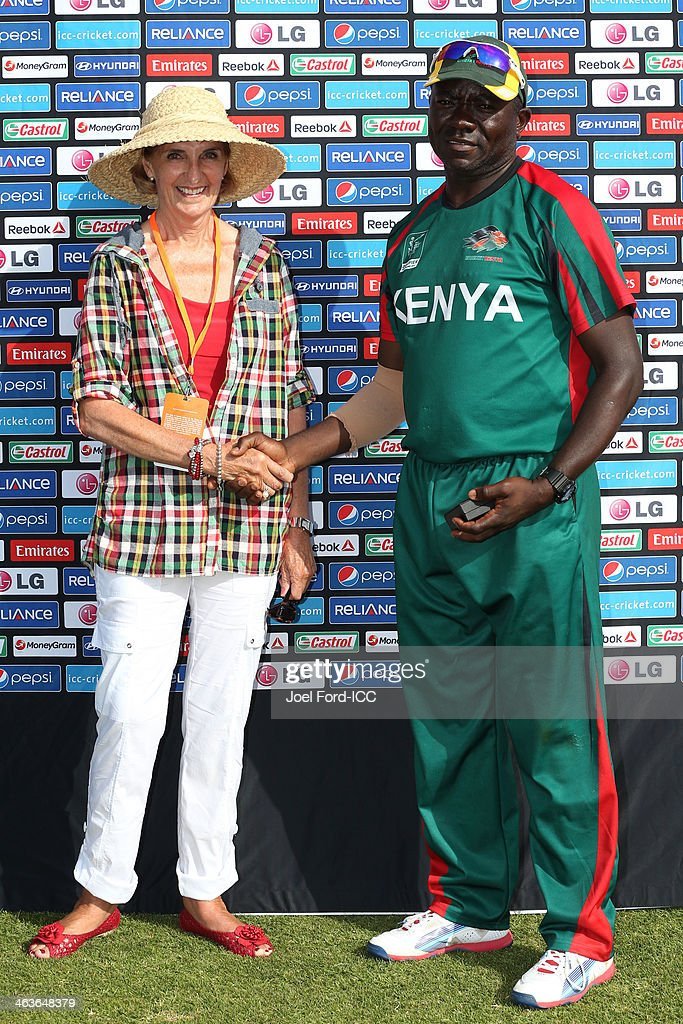 Sally Morrison of the Bay of Plenty Cricket Trust presents Steve Tikolo of Kenya with the man of the match award after an ICC World Cup qualifying match between Kenya and Uganda on January 19, 2014 in Mount Maunganui, New Zealand.
