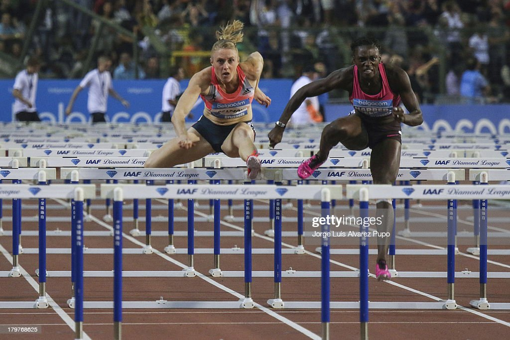 Sally Pearson (AUS) and Dawn Harper-Nelson (USA) jump a hurdle in the womens's 100m hurdles final during the 2013 Belgacom Memorial Van Damme -IAAF Diamond League on September 6, 2013 in Brussels, Belgium.