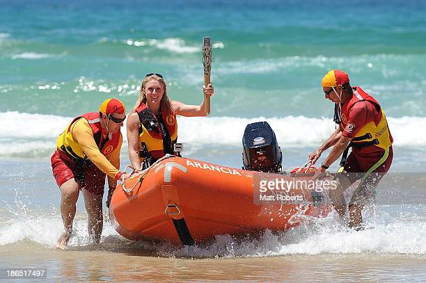 Sally Pearson holds the Queen's Baton as the Commonwealth Games Baton arrives on the Gold Coast on November 1 2013 in Surfers Paradise Australia The...