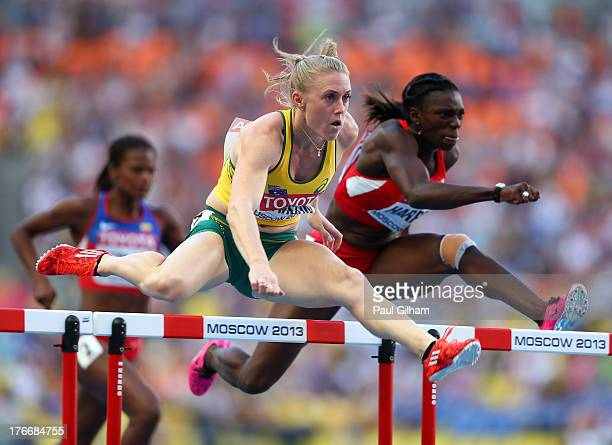 Sally Pearson of Australia and Dawn Harper of the United States compete in the Women's 100 metres hurdles semi finals during Day Eight of the 14th...