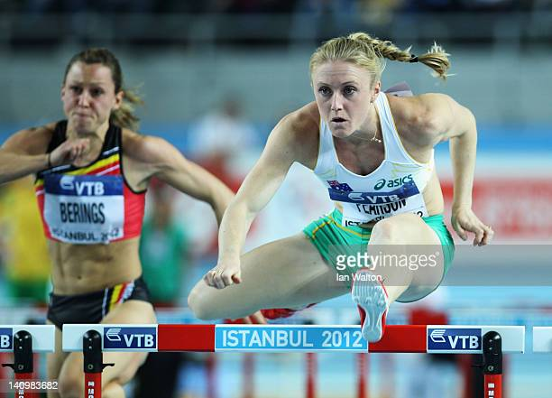 Sally Pearson of Australia and Eline Berings of Belgium compete in the Women's 60 Metres Hurdles first round during day one of the 14th IAAF World...