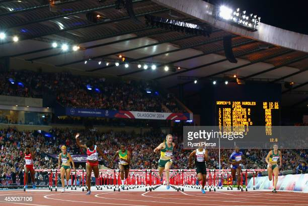 Sally Pearson of Australia crosses the line to win gold ahead of Josanne Lucas of Trinidad and Tobago Shannon McCann of Australia Tiffany Porter of...