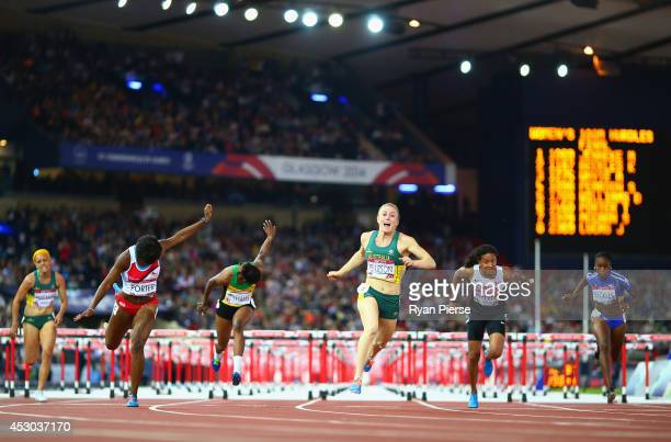 Sally Pearson of Australia crosses the line to win gold ahead of Shannon McCann of Australia Tiffany Porter of England Danielle Williams of Jamaica...