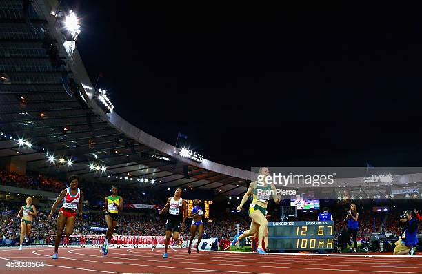 Sally Pearson of Australia crosses the line to win gold ahead of Tiffany Porter of England in the Women's 100 metres hurdles finalat Hampden Park...