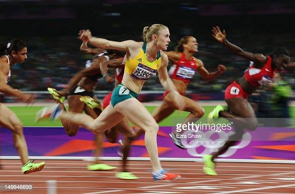 Sally Pearson of Australia crosses the line to win gold in the Women's 100m Hurdles Final on Day 11 of the London 2012 Olympic Games at Olympic...