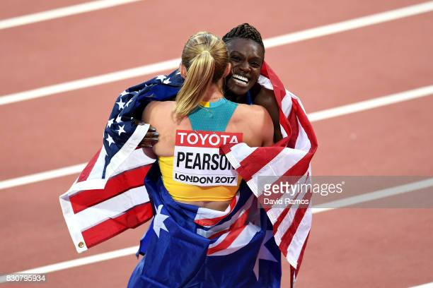 Sally Pearson of Australia gold celebrates with Dawn Harper Nelson of the United States silver after the Women's 100 metres hurdles final during day...